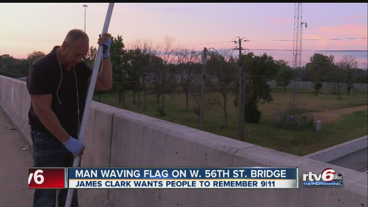 Indy man again honors 9/11 victims by waving flag on northwest side overpass