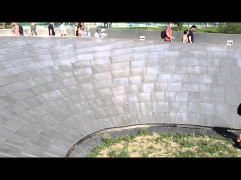 Aleta and Shizuka Slide Down the BP Bridge in Millenium Park, Downtown Chicago