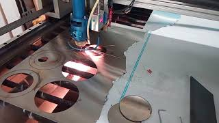 Home made laser cutter cutting 2 mm stainless steel part 2