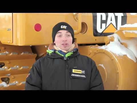 Finning Mechanic Servicing Cat® Equipment in Antarctica