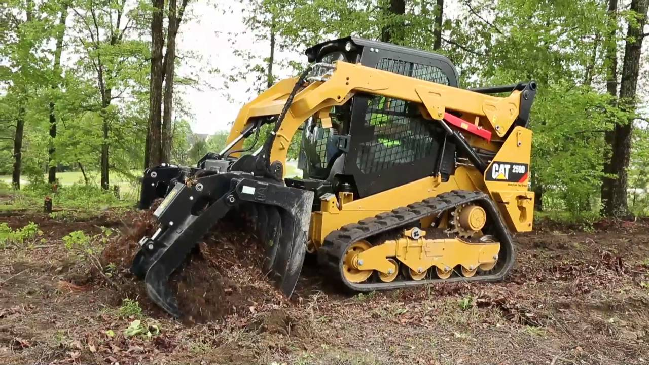 Cat 174 Grapple Rake Attachment At Work Youtube