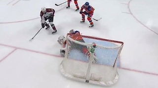 Brossoit slides across to make a big save on Comeau