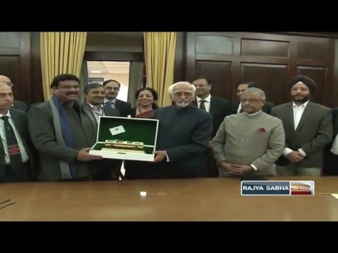 Sh. Md. Hamid Ansari handing over a replica of a TAPI project Capsule to Sh. Dharmendra Pradhan