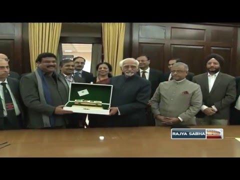 Sh. Md. Hamid Ansari handing over a replica of a TAPI project Capsule to Sh. Dharmendra Pradhan