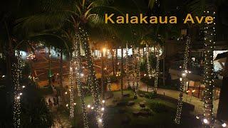 Waikiki : Kalakaua Ave 夕暮れのカラカウア通りの街並みにキラキラと明かりが灯るメインストリート