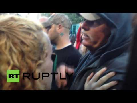 USA: Fists fly as 'cowboy' nationalists fail to stop anarchists burning US flag on 4th of July