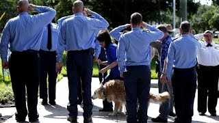 Officers Honor Last 9/11 Search Dog With Moving Tribute Before Being Put Down