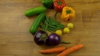 Healthy and fresh vegetables on a wooden table - stop motion animation
