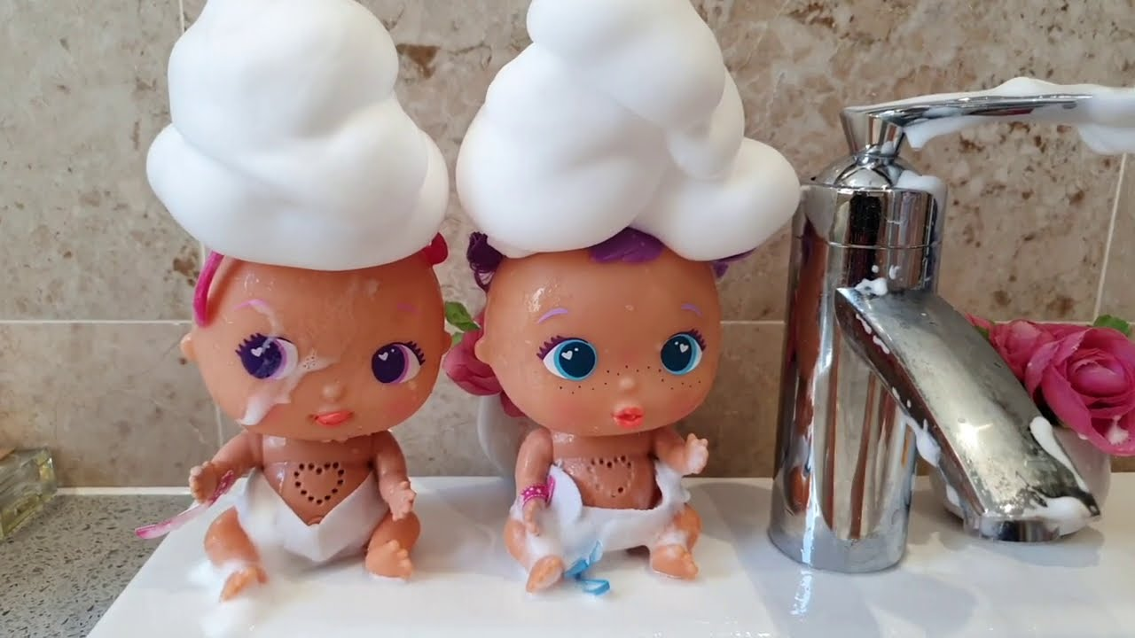 Washing Baby Dolls in the Sink with Foam