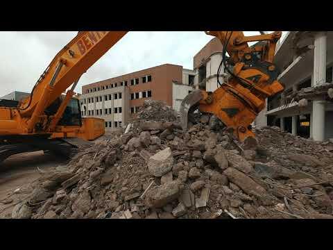 Demolition by Excavator