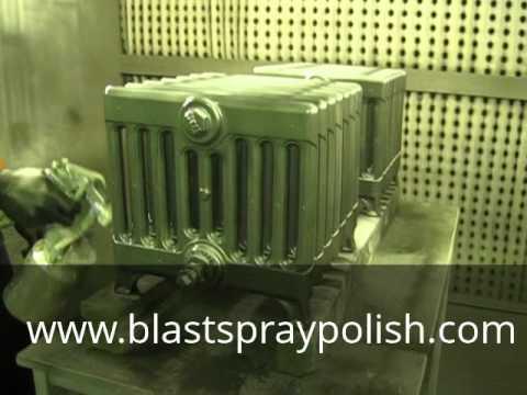 Spray painting radiators with BSP Graphite Grey.