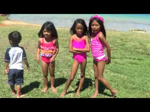 3 little cute  girls dancing at the beach with Rjae