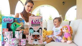 Оливия распаковывает куклы Лол Сюрпрайз / Маленькие Пупсики LOL Hairgoals и LOL Surprise.
