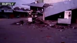 Dozens of buildings collapse after 6 5 quake in Indonesia