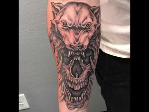 Wolf skull forearm tattoo by Jaymz at Triple Six Artistry