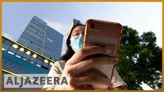 Surveillance-savvy Hong Kong protesters go 'digitally dark'