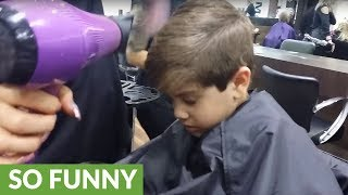 Kid falls asleep during entire haircut