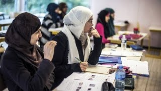 vuclip German court rules, Muslim women teachers can wear headscarves