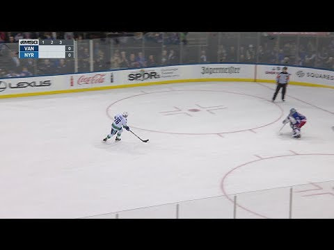 Vesey, Rangers outlast Canucks in seven round SO