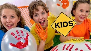 Color Balloon Paint Hand Prints with Sign Post Kids!