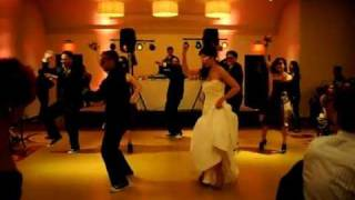 Wedding Party Does Jump On It Dance