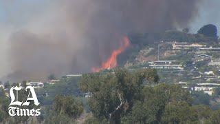 Brush fire in Pacific Palisades threatens homes