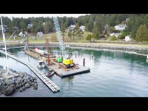Pile driving barge arrives at Rosario Resort Marina
