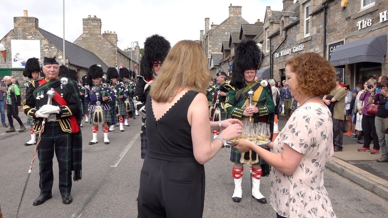 Download Massed Pipes & Drums parade stops to enjoy a wee dram before 177th Tomintoul Highland Games