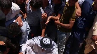 جثمان الشهيد حسين نعيم الكيم يوارى الثرى بقبره بجانب نور عيني وفلذة كبدي الشهيد غيث نعيم الكيم