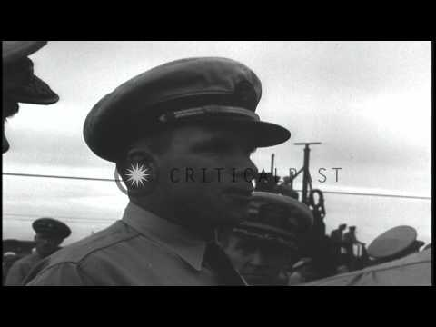 Sailors and officers aboard USS Wahoo which is approaching the submarine base at ...HD Stock Footage