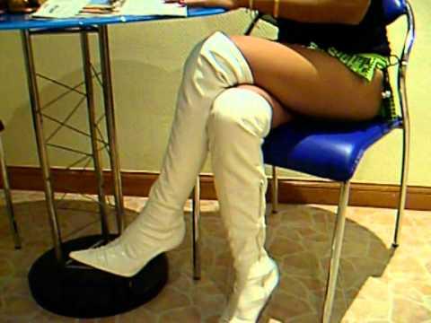 Sexy Khmer Natyaba sitting down  in white PVC boots