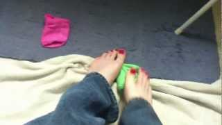 Taking off my pink and green ankle socks to show my bare feet and painted toes