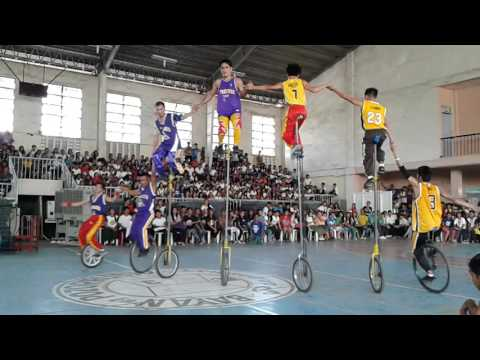 triple k acrobats playing basketball  using 3, 7 & 12 foot high unicycle