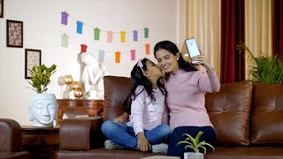 Happy Indian mother and daughter spending quality time together at home