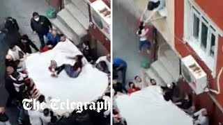 video: Watch: Locals catch residents jumping from a burning apartment in Istanbul