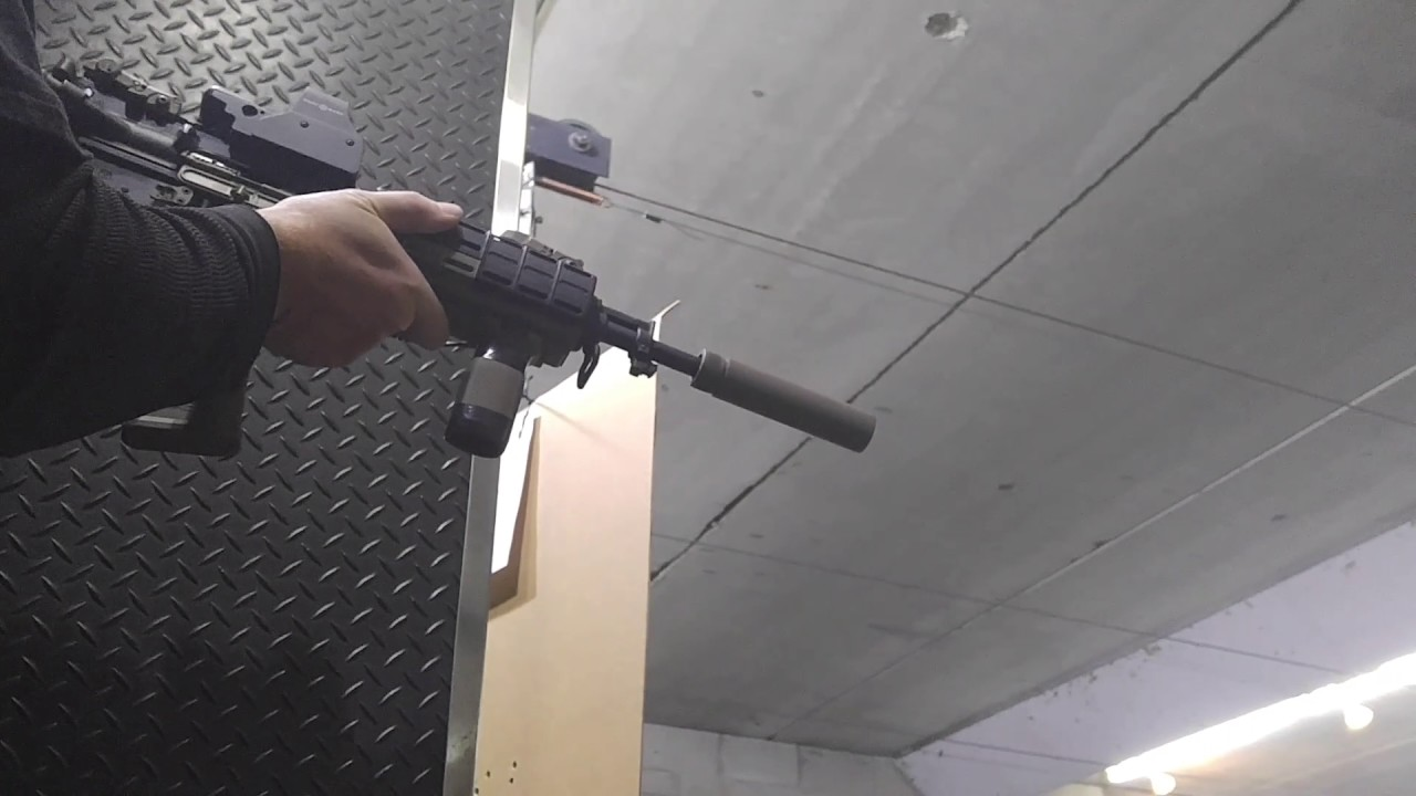 Shooting AR-15 with a fake suppressor