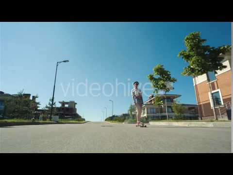 Woman Down The Road With Skateboard - Stock Footage | VideoHive 15532870