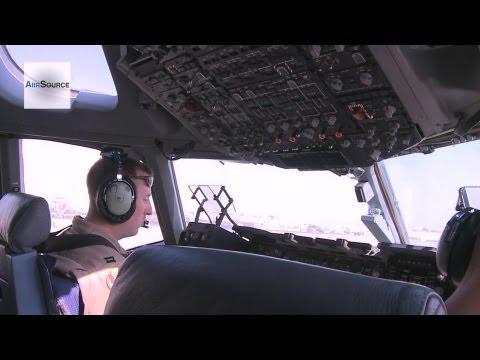 C-17 Transports Cargo and Passengers. Cockpit View, Takeoff, Landing.