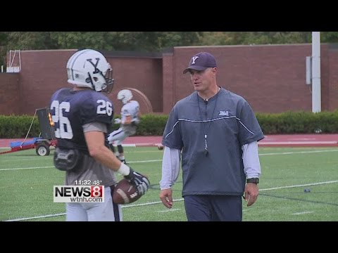 Yale football head coach Tony Reno mic