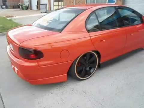 holden vx custom bonnet guards orange monster wheels lowered king springs  sexy machine