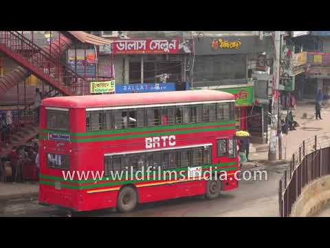 BRTC double-decker buses and decorated cycle rickshaws in Dhaka