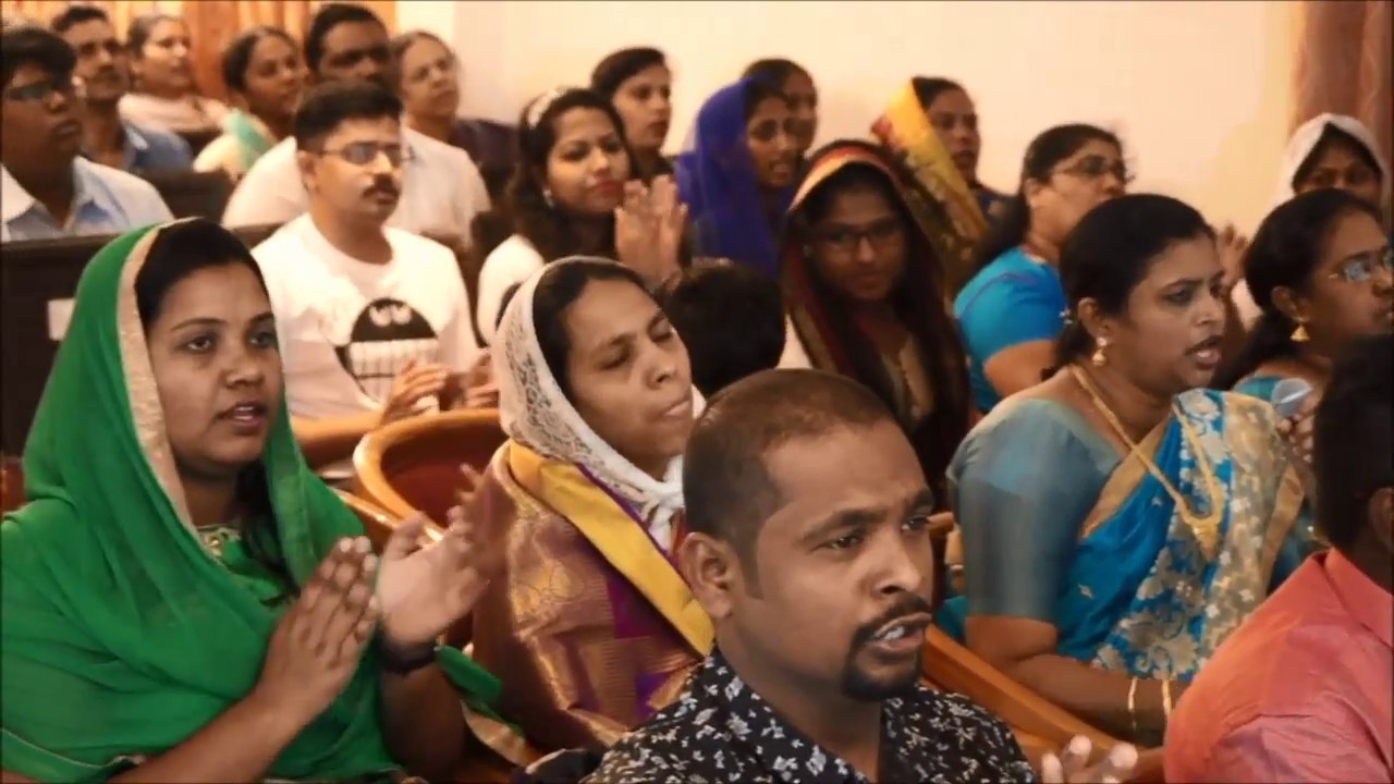 People Praising God In Church