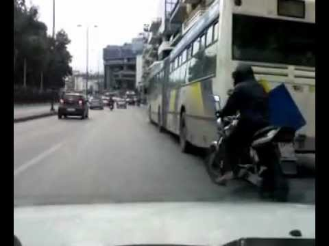 Fail - motorcycle nearly bumps on bus