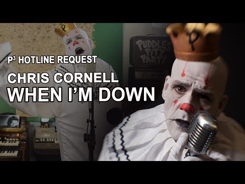 "7-Foot Tall Clown with a Golden Voice Sings Chris Cornell's ""When I'm Down:"" A Tribute Filled with Raw Emotion"