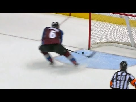 Erik Johnson races back to save the empty net