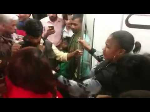 African women fighting for seat in Delhi metro
