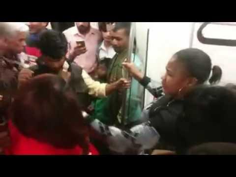 African women fighting for seat in Delhi metro