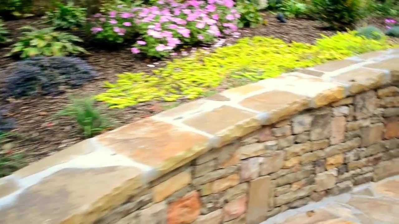 Back Yard Stone Retaining Wall and Flowers - YouTube