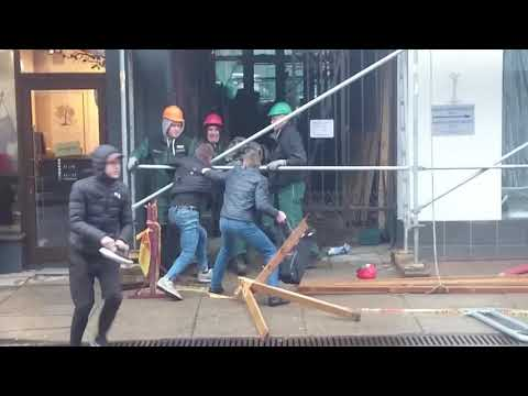 Crazy angry people fight on the Street in lithuania kaunas City