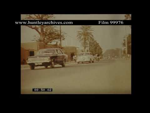 Street in town in Nigeria, 1970's.  Archive film 99976